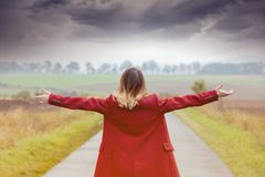 Back side view at redhead woman in red coat Royalty Free Stock Photos