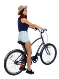 Back side view of a woman with a bicycle. Royalty Free Stock Photo