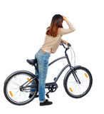 Back side view of a woman with a bicycle. Stock Photography