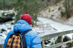 Back side of walking man hiking outdoors in winter Stock Photos