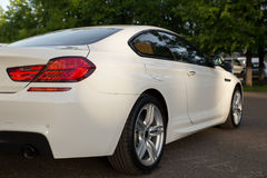 Back side of white luxury beautiful car Royalty Free Stock Photo