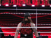 Back side of WWE Wrestle Bray Wyatt as he stands in ring for mat Stock Photos