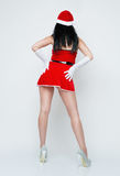 Back site  beautiful and sexy woman dresses as sexy santa claus. Back site  beautiful and sexy woman dresses as a sexy santa claus Royalty Free Stock Photography