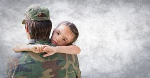 Back of soldier with daughter against white wall with grunge overlay stock photo