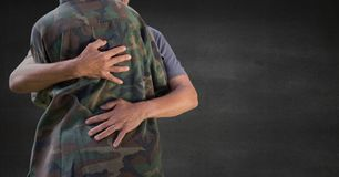 Back of soldier hugging against grey wall stock image