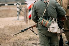 Back of the soldier Wehrmacht in uniform and with a rifle. A soldier from the Wehrmacht from the back with the equipment of a German soldier of the Second World royalty free stock images
