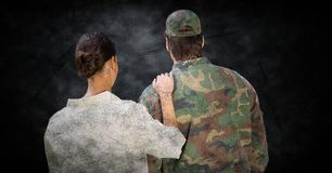 Back of soldier and wife against black grunge background with overlay stock photography