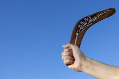 Back Soon - Boomerang - Australia. Boomerang - Back Soon - A boomerang is a throwing tool, constructed as a flat airfoil, that is designed to spin about an axis Stock Image