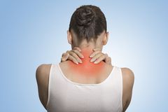 Back spine disease. Closeup view tired female massaging her neck Royalty Free Stock Image