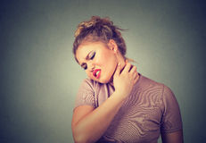 Back and spine disease. Tired woman massaging her painful neck Royalty Free Stock Photography