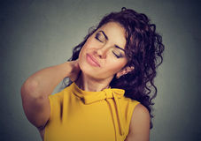 Back and spine disease. Woman massaging painful neck royalty free stock images