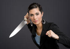Woman in Business Suit poised for knife attack Royalty Free Stock Photo