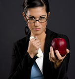 Woman Showing Jekyll Hide Personality Disorder. Woman holds Apple in front and a big knife inside her jacket Stock Images