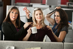 Back-stabbing Colleagues. Threatening employee with scissors and knife Stock Photo