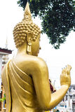 Back Standing Thai Golden Buddha statue Royalty Free Stock Image