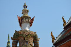 Back of the statue and roof in grand palace in bangkok Stock Photos