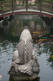 Back of a stone carve of Koi carps Royalty Free Stock Photo