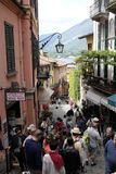Lake Como:a street in Bellagio. A back street busy with visitors standing in front of shops and bars in Bellagio, Lake Como Stock Photos