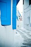 Back street, Mykonos. Blue shutters close-up on a quiet back street in Mykonos, Greece Stock Photography