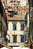 Back streets of Dubrovnik with flag Royalty Free Stock Photo