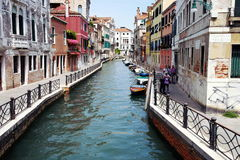 The Back Streets of Venice. A winding canal surrounded by beautiful buildings  in the scenic city of Venice, Italy Stock Photos