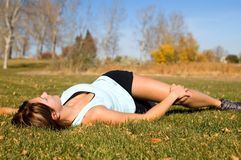 Back Stretch. Woman doing lower back laying down Stretch Stock Image
