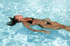 Swimming girl in summer pool holydays. Back swimming girl in summer pool holydays Stock Photos