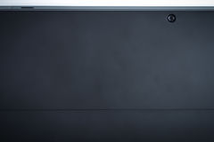 The back of tablet black background with camera, modern look Royalty Free Stock Images