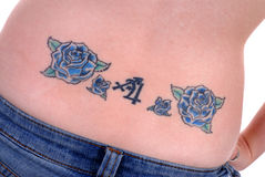 Back Tattoo. Floral tattoo design on a girl's back stock image