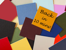 Back in Ten Minutes! Back soon sign for business. Back in Ten Minutes! Back soon sign for business with office post-its stock photo