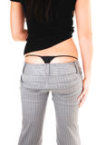 The back and thong of woman. The back of an young woman in a gray dress pants and black sweater Royalty Free Stock Photos
