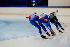 Back three women athletes speed skaters Royalty Free Stock Image