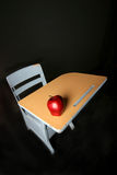 Back to it. School desk with apple Stock Photos