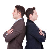 Back to back businessmen. Looking away from the camera over white background Stock Photos