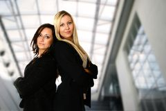 Back to back businesswoman Stock Photo