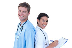 Back to back doctors and nurses  on a white background Stock Images