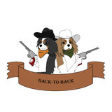 Back-to-back dogs. Two cavalier spaniel dogs sitting back to back with pistols Stock Photos