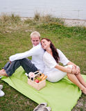 Back to back on romantic picnic. A young couple having fun on a romantic picnic Stock Photo