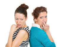Back to back, sad women Royalty Free Stock Photo