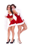 Back to back santa women Royalty Free Stock Images