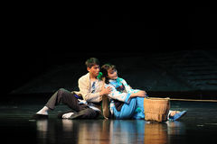 Back to back sitting on the ground- Jiangxi opera a steelyard Royalty Free Stock Photo