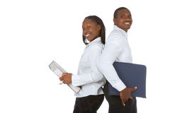 Back to back students. Two African-American office workers with folders or african male and female student Stock Image