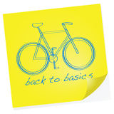 Back to basics. Cartoon illustration showing a sketch of a bike on a sticky note with the words Back to basics under it Stock Photo