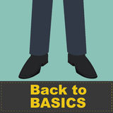 Back to Basics on front of business man feet Royalty Free Stock Photos
