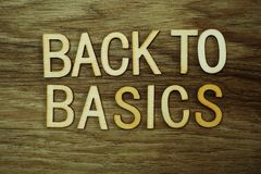 Back To Basics text message on wooden background stock image