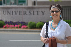 Back to College. Older woman is ready to go back to study at college Stock Photos