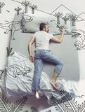 Top view photo of young man sleeping in a big white bed and his dreams royalty free stock photography
