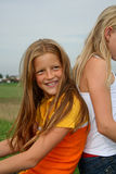 Back to friend. Young girl back to back with friend Royalty Free Stock Photo