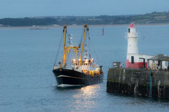 Back to home. A fishing boat that evening back in the port Royalty Free Stock Photo