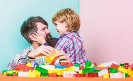 Back to our roots. child development. building home with colorful constructor. happy family leisure. father and son play royalty free stock images